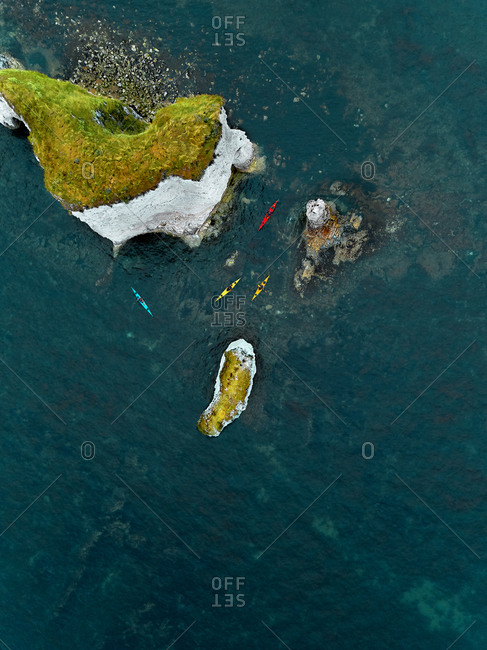 Aerial view of some kayaks around the iconic Old Harry Rocks in Studland, Dorset, United Kingdom.