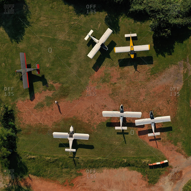 Aerial view of a bunch of ultralight airplanes parked in a private airfield in Senago, Lombardy, Italy.