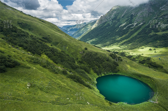 Aerial view of little lake in the mountains of Caucasus Nature Reserve in summer season, Sochi, Krasnodar Krai, Russia
