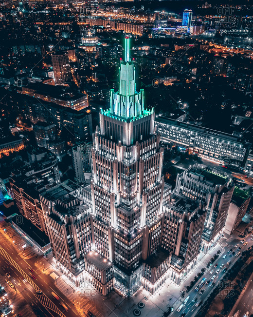 September 3, 2020: Aerial view of illumination of the business center Oruzheyniy which looks like an ancient ziggurat in the midst of night city lights, Moscow, Russia