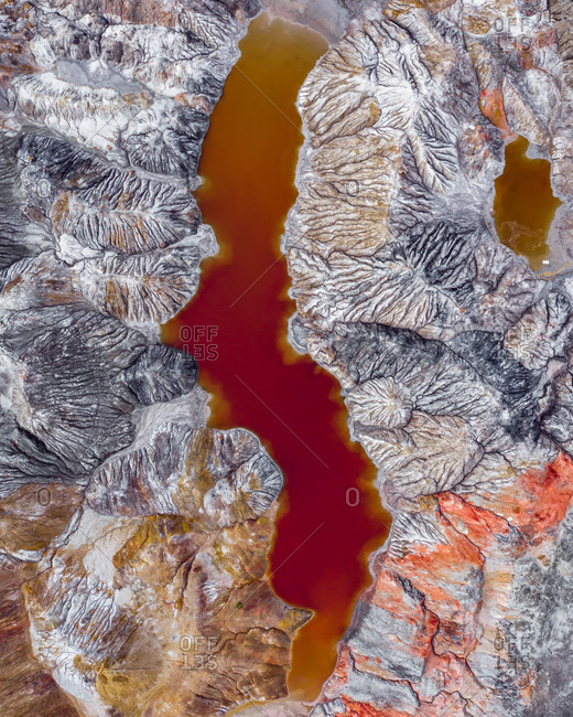 Aerial view of the Martian landscape of industrial production of refractory clays with a red colored water reservoir, Bogdanovich, Sverdlovskaya oblast, Russia.