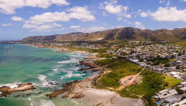 Panoramic aerial view of Hermanus with Kammabaai Beach in summer clear sea, South Africa