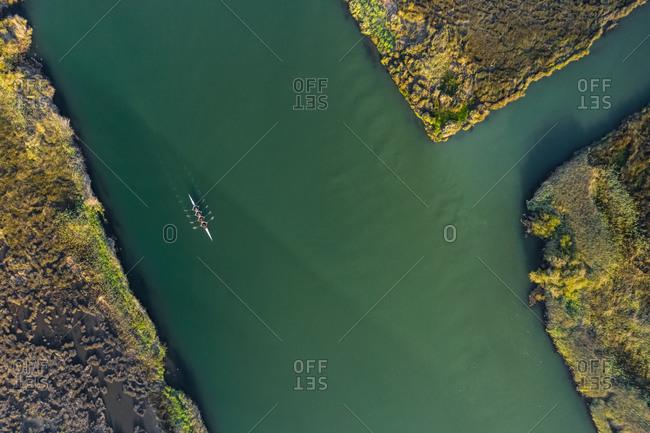 Aerial view of a group of men doing sport in a Kayak in estuary of river Vouga, in Ria de Aveiro, Bioria, Salreu, Estarrega, Aveiro, Portugal