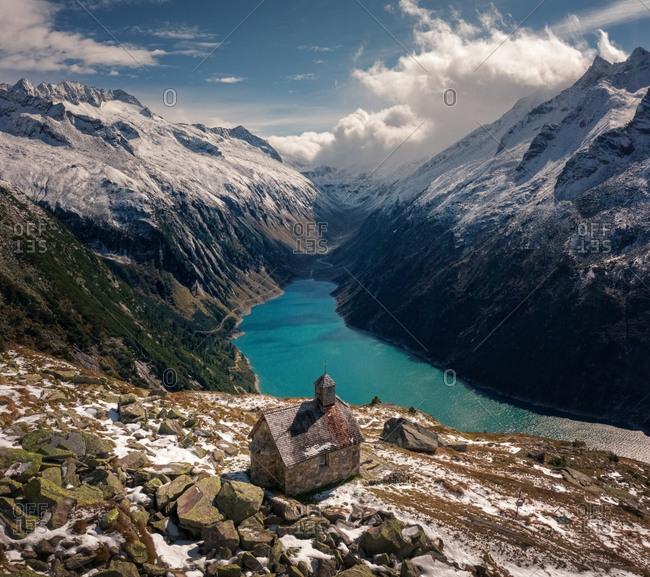 Aerial view of St. Valentin church and reservoir in Zillertaler Alps, Tirol, Austria