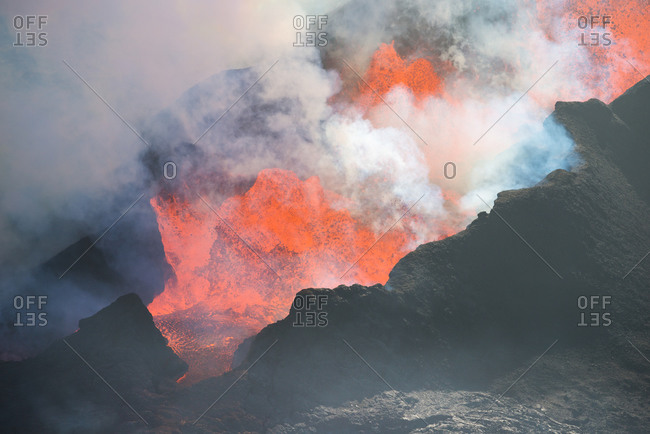 Aerial view of crater with spewing lava, smoke and gases during the largest volcanic eruption in Iceland since 1784, Holuhraun, highlands of Iceland