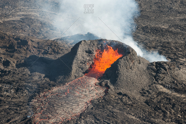 Aerial view of small crater with spewing lava during the largest volcanic eruption in Iceland since 1784, Holuhraun, highlands of Iceland