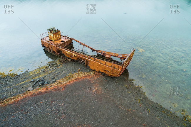 Aerial view of rusty shipwreck in a fjord, Mjoifjordur, Eastfjords of Iceland