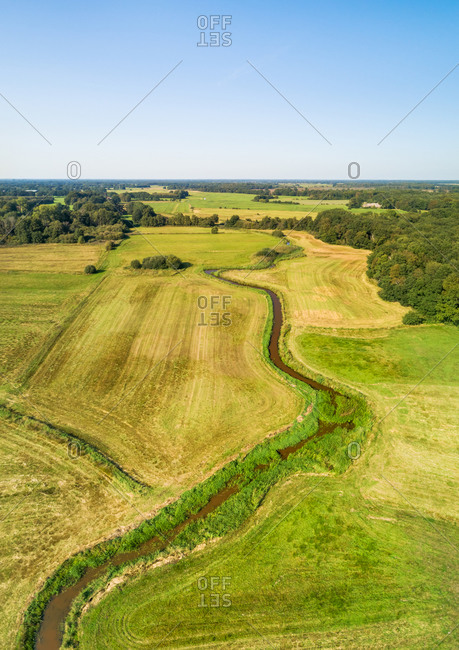 Aerial view of grasslands with the winding river Reest, border between the provinces of Overijssel (to the left) and Drenthe (to the right), Netherlands