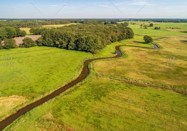 Aerial view of grasslands with the winding river Reest, border between the provinces of Overijssel (to the right) and Drenthe (to the left), Netherlands
