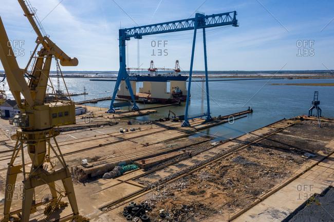 October 17, 2020: Aerial view of cranes in harbor of Huelva in Spain.