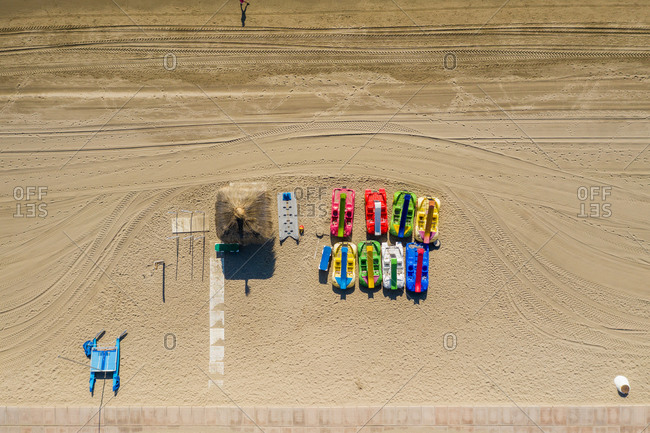 Aerial view of paddle boats on beach in Marbella, Malaga, Spain