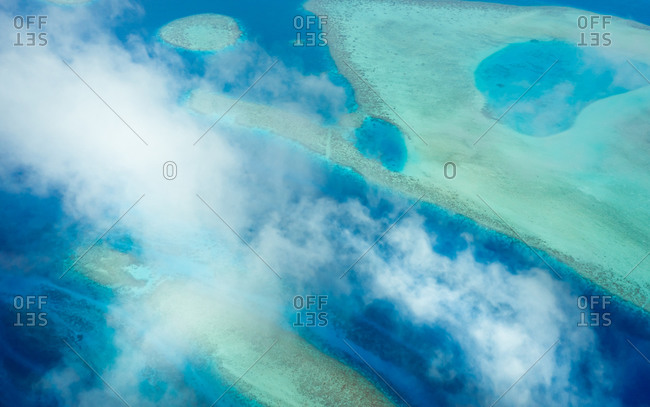 Panoramic aerial view of Vaavu Atoll with clouds, Maldives, Laccadive Sea.