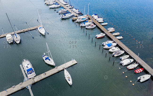 Aerial view of anchored sailing and fishing boats, Gothenburg Archipelago, Sweden.