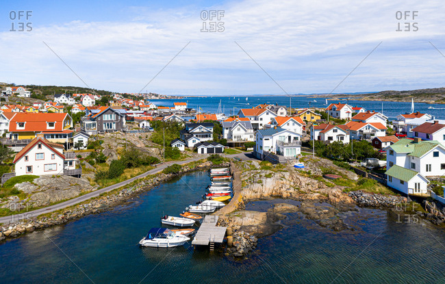 Panoramic view of an island with anchored colorful boats in a small bay, Gothenburg Archipelago, Sweden.