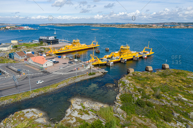 July 25, 2020: Aerial view of the ferry terminal with two yellow car ferries Gothenburg Archipelago, Sweden.