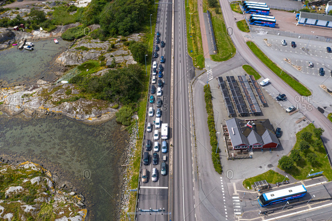 July 25, 2020: Aerial view of the ferry terminal with cars lining up and parking area, Gothenburg Archipelago, Sweden.