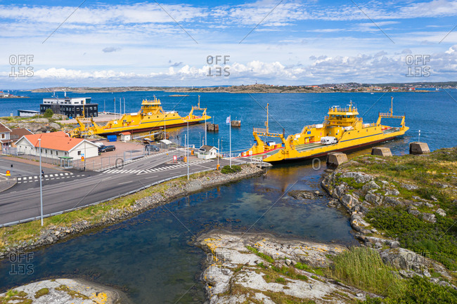 July 25, 2020: Aerial view of the ferry terminal with two yellow car ferries, Gothenburg Archipelago, Sweden.