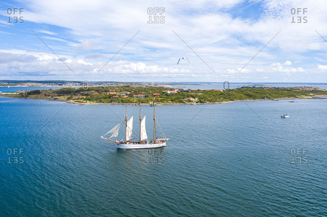 Aerial view of a sailing boat cruising at the coast, Kattegat, Gothenburg Archipelago, Sweden.