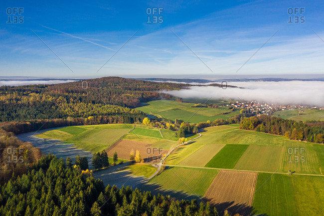 Panoramic view of a rural autumn landscape with fog, Germany.