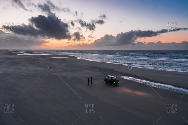 Aerial view of a camper van driving over the beach of the island Terschelling, Friesland, The Netherlands.