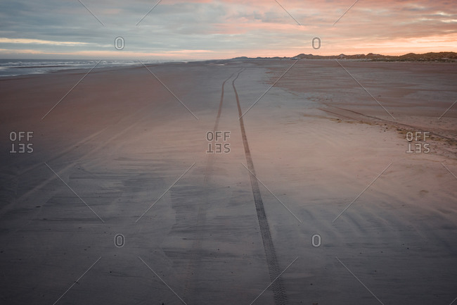 Aerial view of vehicle tracks on a wide stretched beach on the island Terschelling, Friesland, The Netherlands.