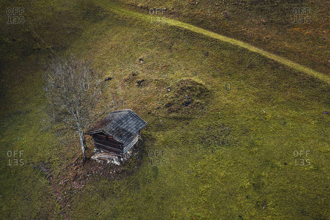 Aerial view of a little shed on the hills of Kaprun, Austria.