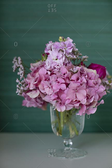 Pink floral arrangement in a glass vase