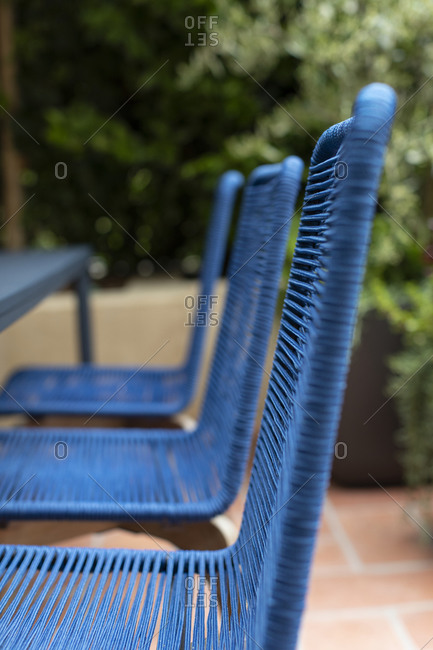 Blue chairs on an outdoor patio