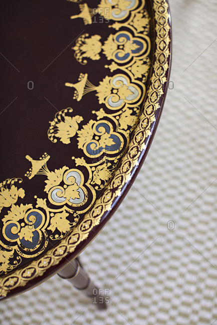 Overhead view of marron table with gold detail