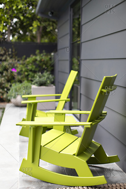 Vibrant green rocking chairs on a porch
