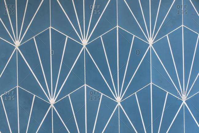 Blue and white hexagon wall tile with white lines