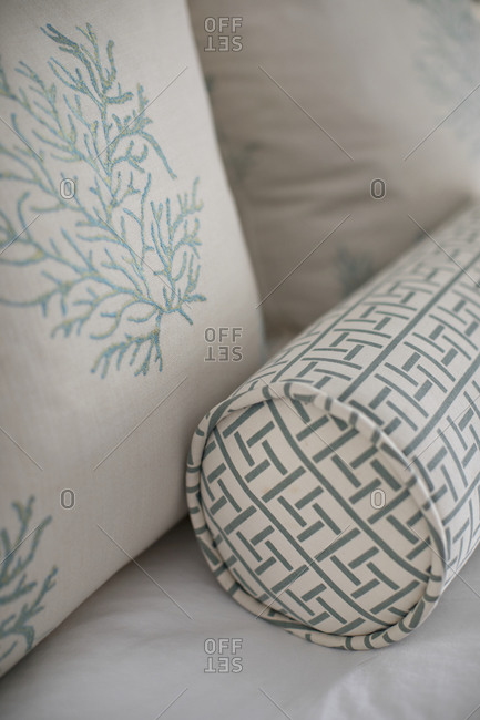White and blue throw pillows close up