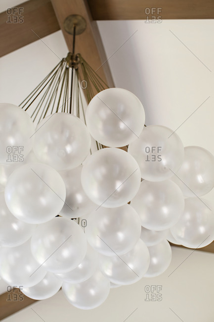 Low angle view of a modern light fixture with round globes