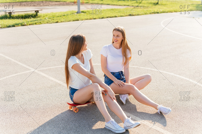 Teenage Generation Z girls sitting and talking, spending their free time together