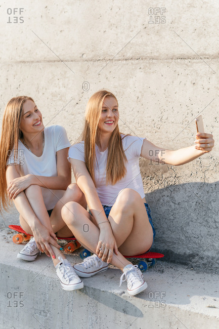 Two teenage Generation Z girls taking a selfie