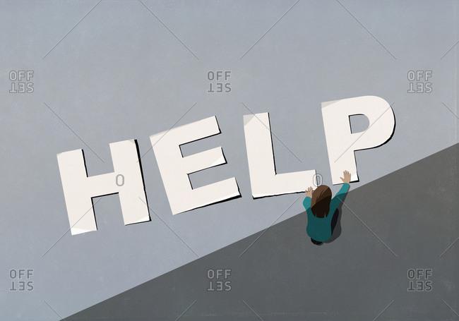 Woman arranging multiple Help letters