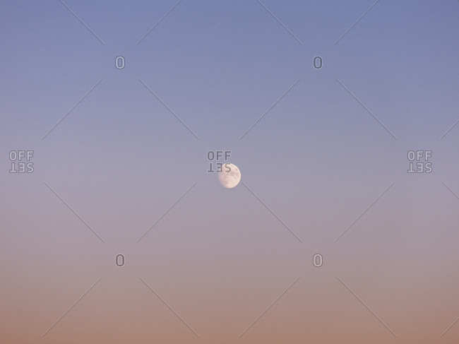 Near full moon in tranquil dusk sky