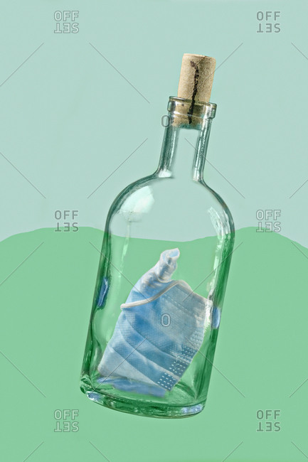 Protective face mask inside bottle with cork