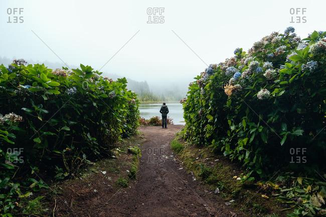 Silhouette of a tourist man enjoying views