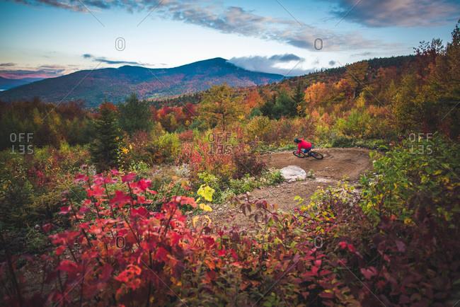 Male mountain-biking in New Hampshire during fall foliage season
