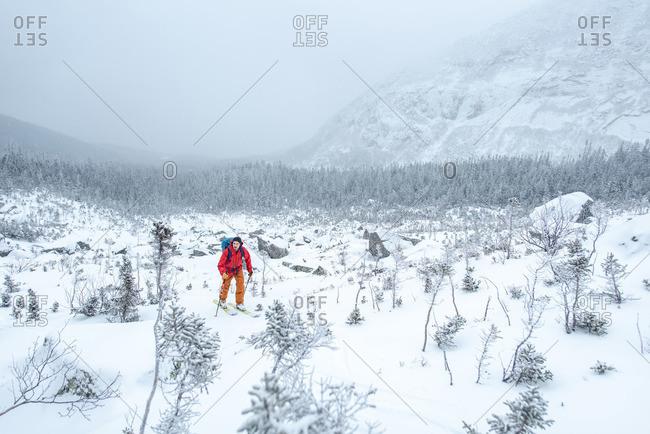 Man skiing through a boulder field in the alpine