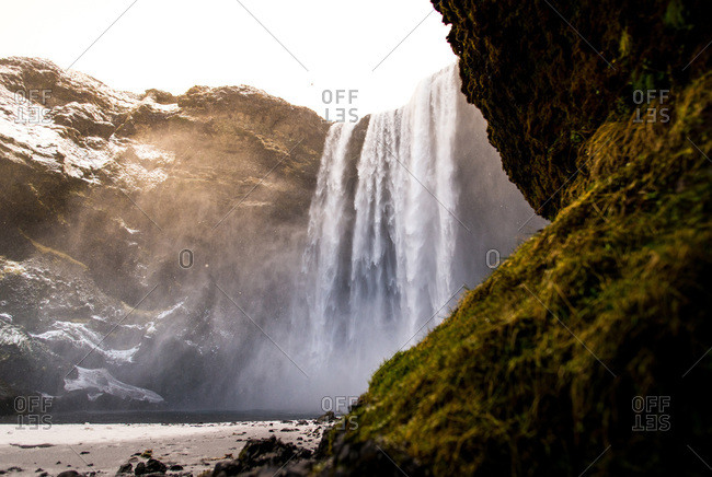 Skogafoss waterfall in the winter with moss in foreground