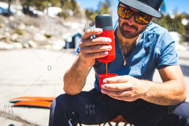 Man making espresso with portable espresso maker