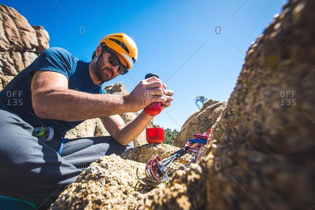 Climber man making espresso with portable espresso maker