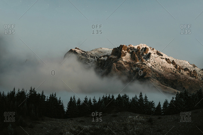 Scenic View of Mountains Covered in Snow and Fog