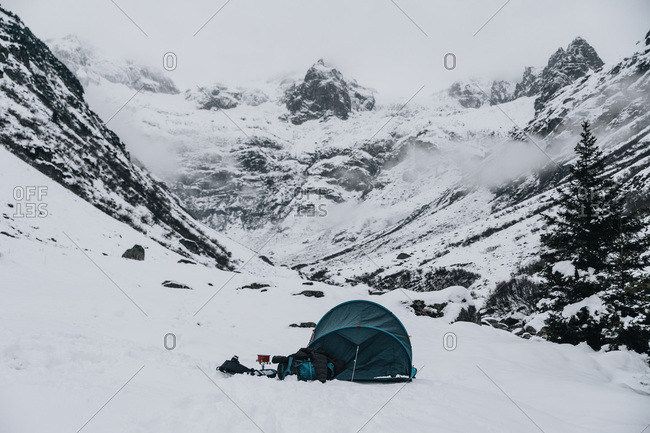 Camping with Blue Tent During Winter on Snow in Switzerland