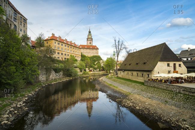Cesky Krumlov, South Bohemian Region, Czechia - April 24, 2018: Cesky Krumlov Castle and Chateau with tower, Cesky Krumlov, South Bohemian Region, Czech Republic