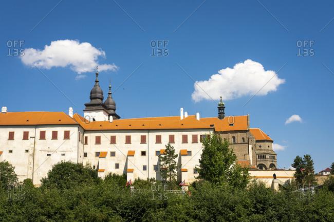 Low angle view of St. Procopius Basilica against blue sky on sunny day, UNESCO, Trebic, Trebic District, Vysocina Region, Czech Republic