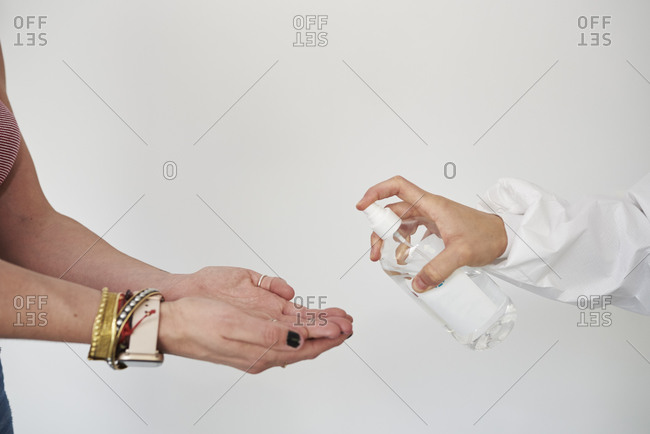 Disinfection of hands with alcohol, to avoid corona virus