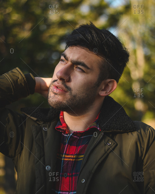 Close up portrait of a handsome white skin man on a road. White male m
